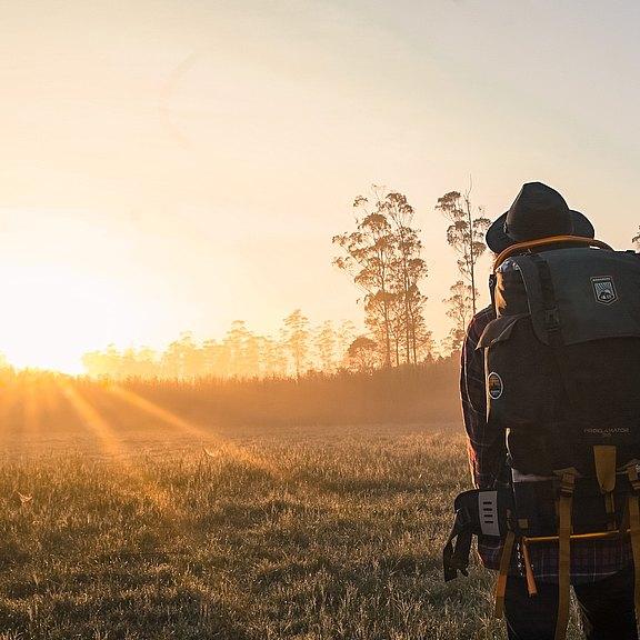 man-in-black-backpack-during-golden-hour-1230302.jpg